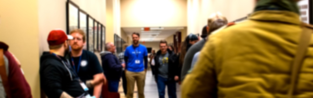 A few groups of PyTN 2019 attendees talking while attending the Hallway Track.